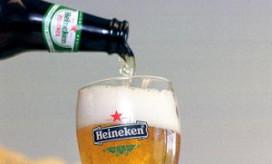 Heineken blijft grondstofprijzen doorberekenen